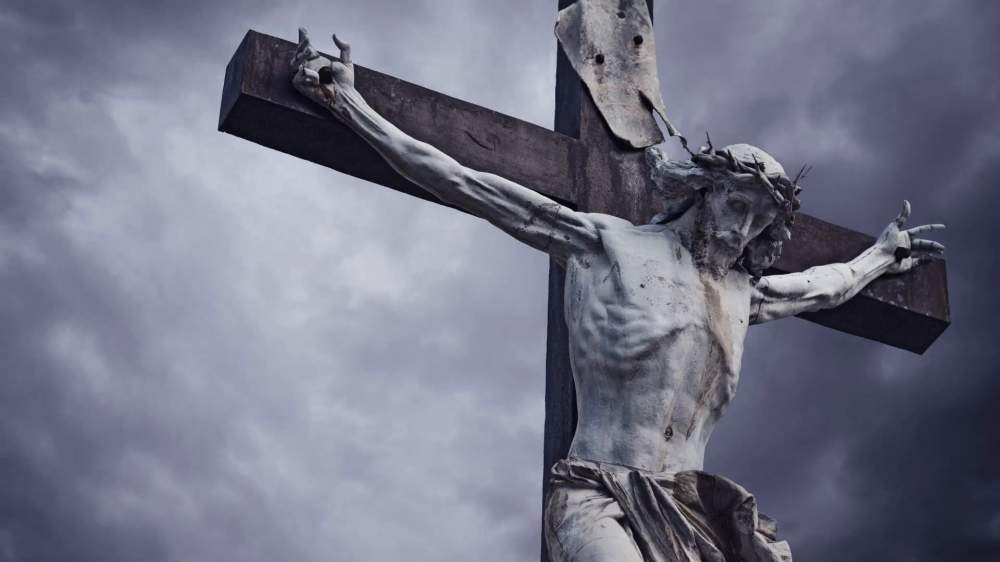 crucifixion-christian-cross-with-jesus-christ-statue-over-stormy-clouds-time-lapse-1920x1080-1080p-hd-format_mkg_pctl__F0000.png