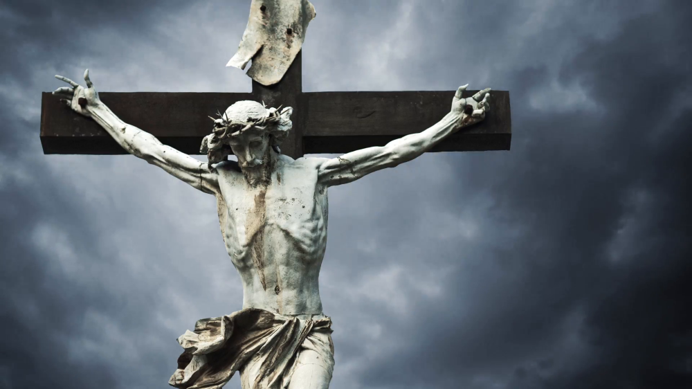 crucifixion-christian-cross-with-jesus-christ-statue-over-stormy-clouds-time-lapse-1920x1080-1080p-hd-format_qk4sa0ki__F0000